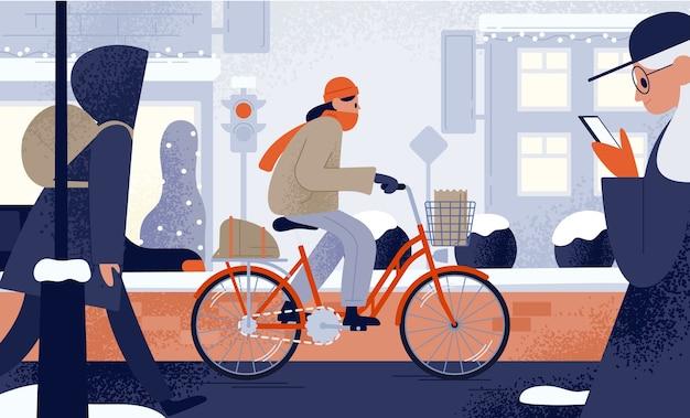 Linda mujer joven vestida con ropa de abrigo montando bicicleta en invierno