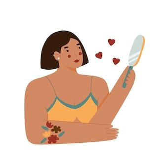 Linda mujer de piel oscura en ropa interior se mira en el espejo y sonríe.