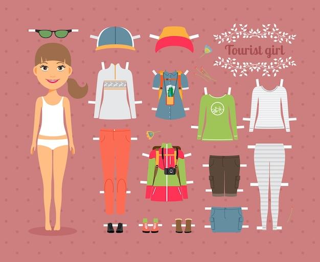 Linda muñeca de papel de niña turista con un conjunto de ropa y zapatos de moda sobre fondo rosa transparente.