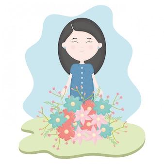 Linda niña con ramo de flores en el campo