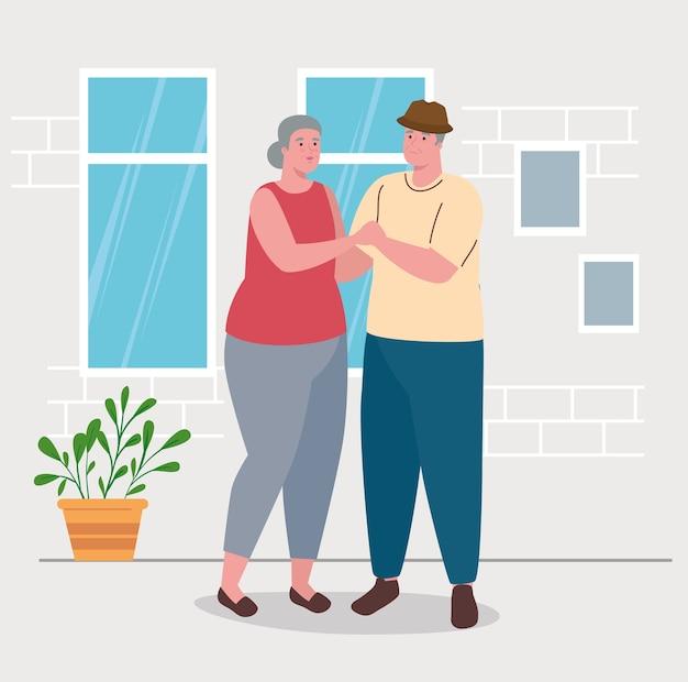 Linda pareja de ancianos bailando en la casa