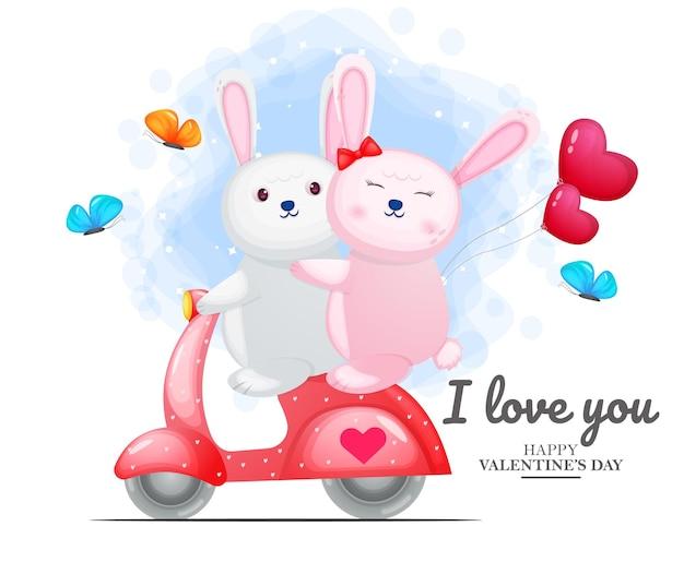 Linda pareja de conejito de san valentín conduciendo scooter rojo
