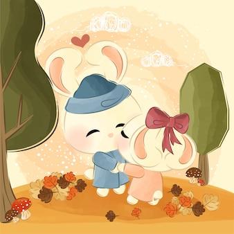 Linda pareja de conejitos en otoño