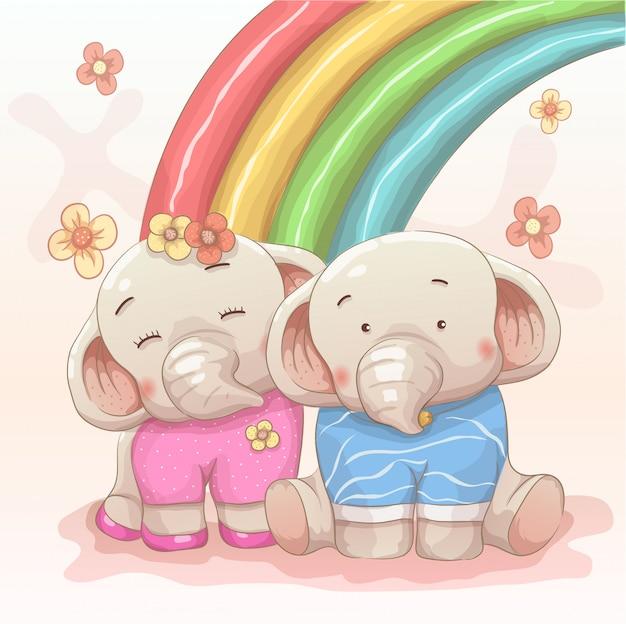 Linda pareja de elefantes se aman con fondo de arco iris