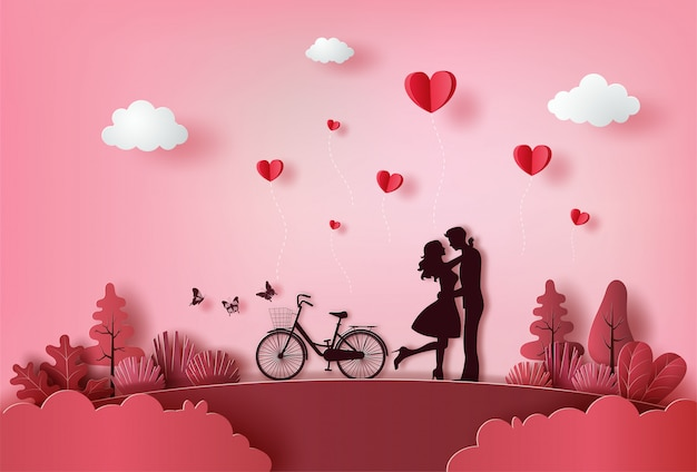 Linda pareja de enamorados abrazándose con muchos corazones flotando.