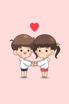 Linda pareja de niño y niña hoding mutuamente mano