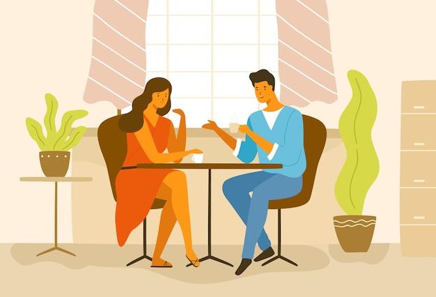 Linda pareja romántica sentada en la mesa de café. novio y novia tomando café y hablando. joven y mujer enamorada en fecha