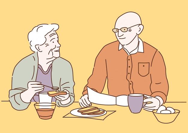 Linda pareja senior de dibujos animados desayunando juntos