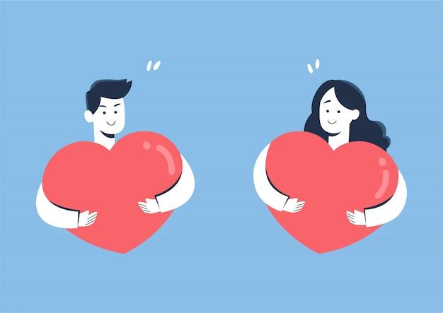 Linda pareja sonriendo mientras abraza el corazón