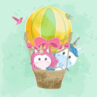 Linda pareja unicornio volando con globo de aire