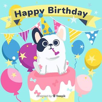 Linda tarjeta de cumpleaños con perro en un pastel