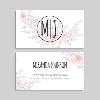 Linda tarjeta de visita con hermosas flores rosas claras