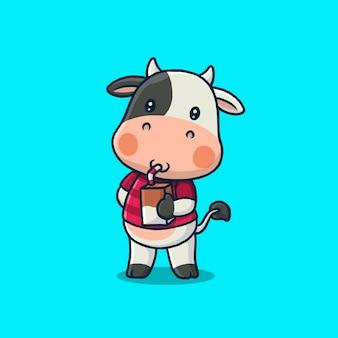 Linda vaca bebiendo una caja de leche aislada en azul