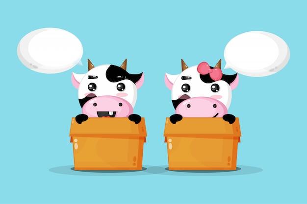 Linda vaca en una caja