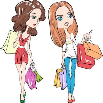 Lindas chicas de moda con bolsas de compras