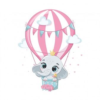 Lindo bebé elefante en un globo de aire caliente.