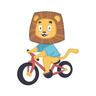 Lindo bebé león montando una bicicleta