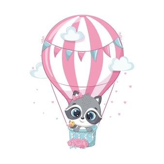 Lindo bebé mapache en un globo de aire caliente.