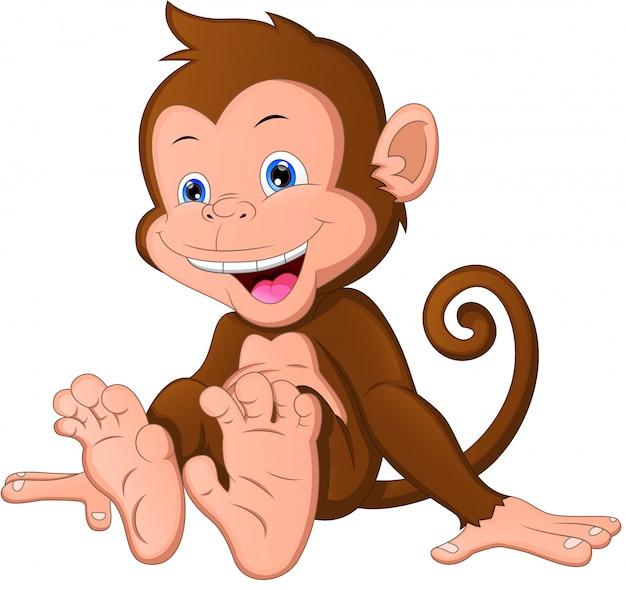 Lindo bebé mono de dibujos animados
