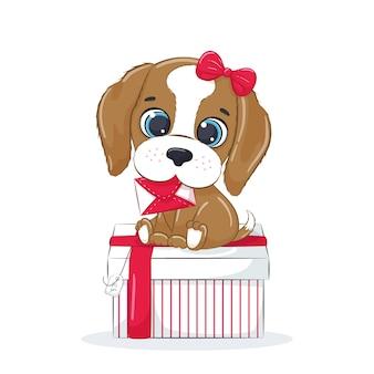 Lindo cachorro en la caja con letra. perro de dibujos animados con arco. regalo para las vacaciones.