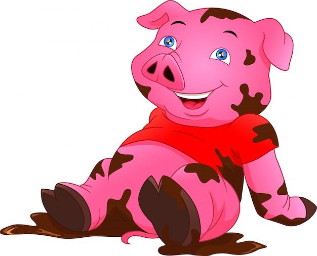 Lindo cerdo jugando barro