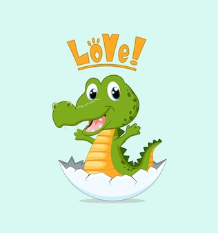 Lindo cocodrilo recién nacido en la cáscara de huevo.