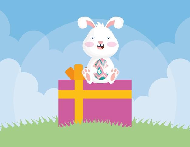 Lindo conejito de pascua con huevo sentado en diseño de ilustración de vector de regalo