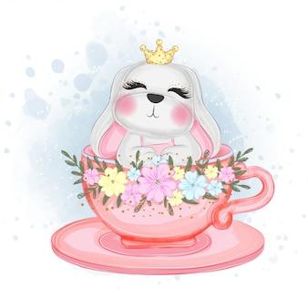 Lindo conejito de pascua en una taza de té ilustración acuarela