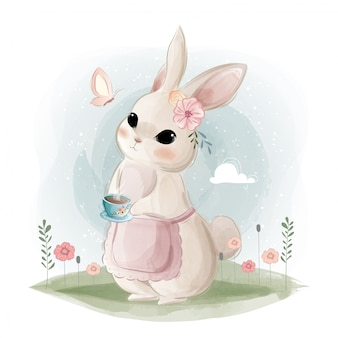 Lindo conejito sosteniendo una taza de té