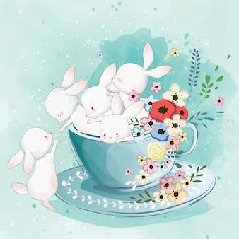 Lindo conejito en la taza de té