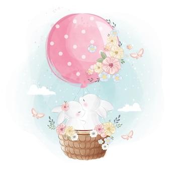 Lindo conejito volando con un globo
