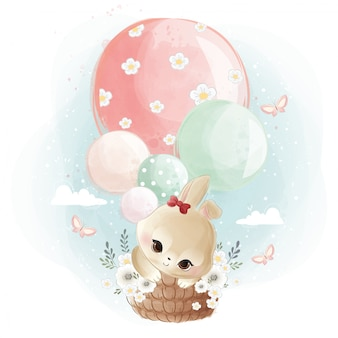 Lindo conejito volando con globos