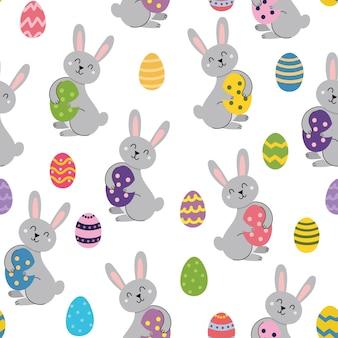 Lindo conejo de pascua con huevo de patrones sin fisuras primavera en estilo de dibujos animados para niños con conejo gracioso