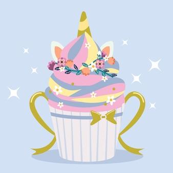 El lindo cupcake de estilo unicornio arcoiris con anillo de flores