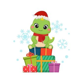 Lindo dinosaurio se sienta encima del regalo de navidad