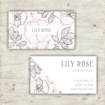 Lindo diseño de tarjeta de visita con flores dibujadas a mano