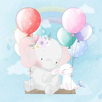 Lindo elefante y conejito volando con globo
