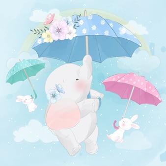 Lindo elefante y conejito volando con paraguas