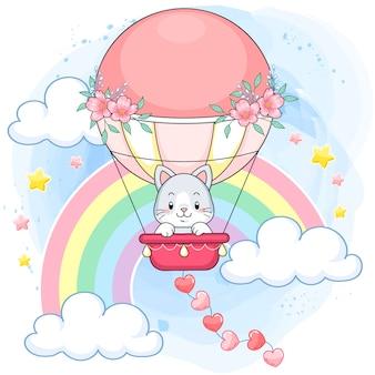Lindo gatito pastel en un globo de aire caliente rosa en un mundo arcoiris