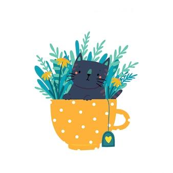 Un lindo gatito se sienta en una taza rodeada de flores y hojas. gato en una taza para niños.