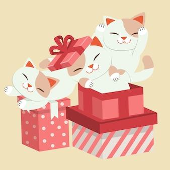 Lindo gato jugando con una ilustración de caja de regalo
