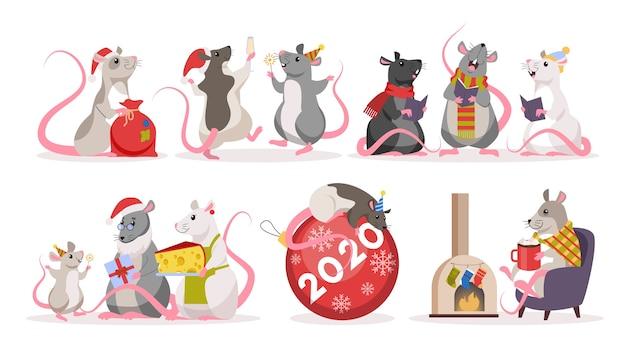 Lindo juego de ratas navideñas. personaje animal con sombrero de santa claus. 2020 año de la rata. ilustración con estilo