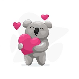 Lindo koala con dibujos animados de almohada de amor