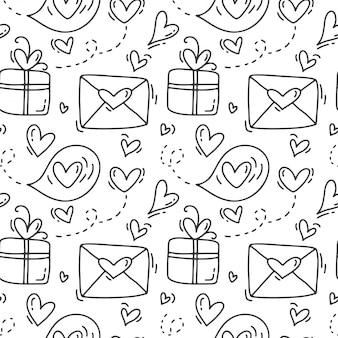 Lindo mano dibujada de patrones sin fisuras con sobres y cajas de regalo