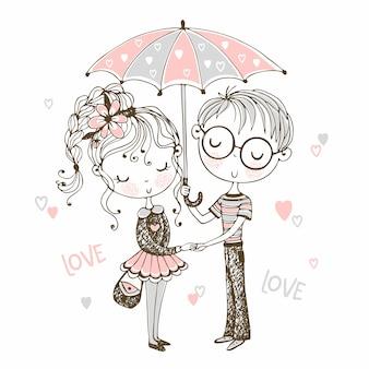 Lindo niño y niña bajo paraguas. cita san valentín.