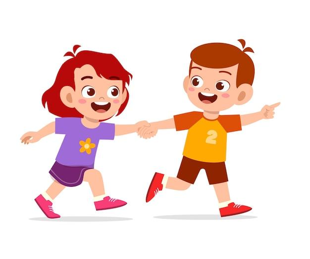 Lindo niño niño y niña tomados de la mano y caminando juntos