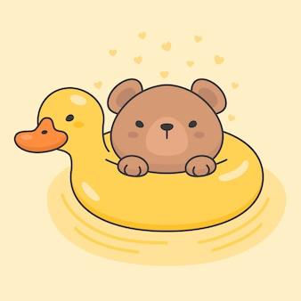 Lindo oso en un anillo de vida de pato