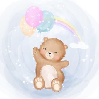 Lindo oso bebé volando con globos
