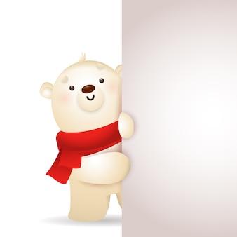 Lindo oso de navidad asomándose desde una pancarta vertical en blanco