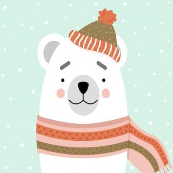 Lindo oso polar en una bufanda y sombrero